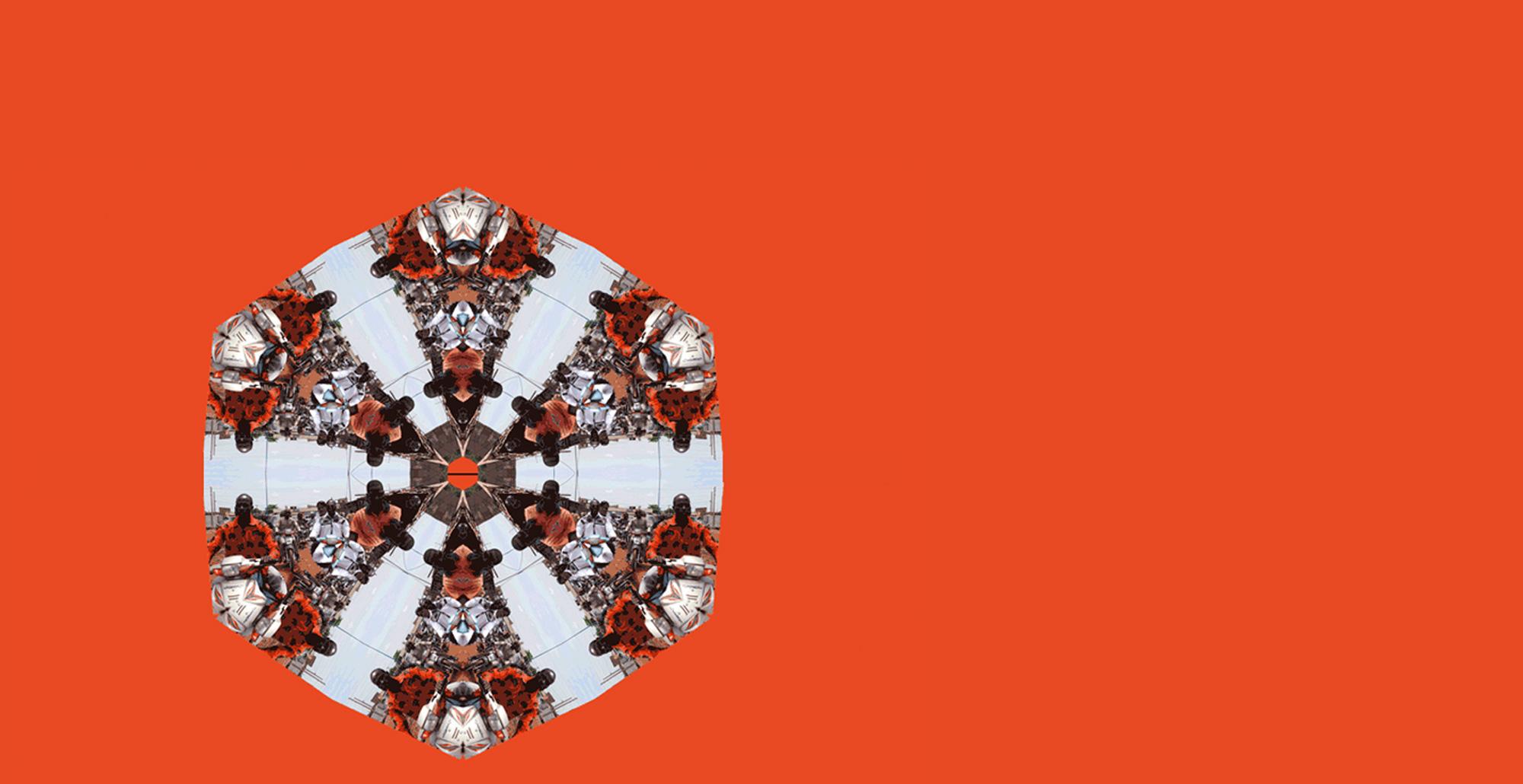 Sfondo arancione con caleidoscopio in primo piano a sinistra